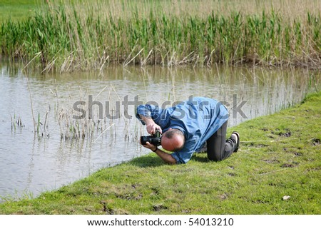 Photographer taking pictures of nature - stock photo