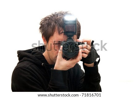 Photographer taking pictures with camera flash activated - stock photo