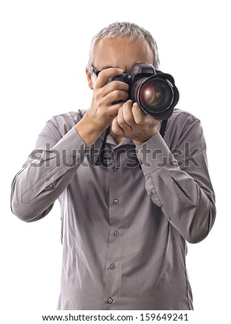 Photographer taking pictures with camera on white