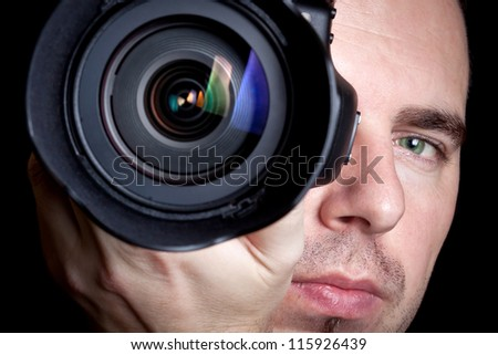 Photographer taking pictures with digital camera - stock photo
