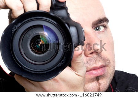 Photographer taking pictures with digital camera over white background - stock photo
