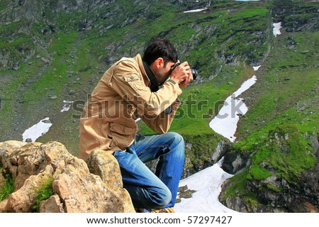 Photographer taking shots in the mountains