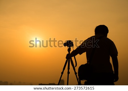 Photographer under the sun - stock photo
