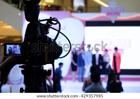 Photographer video recording activity within the event on Stage - stock photo