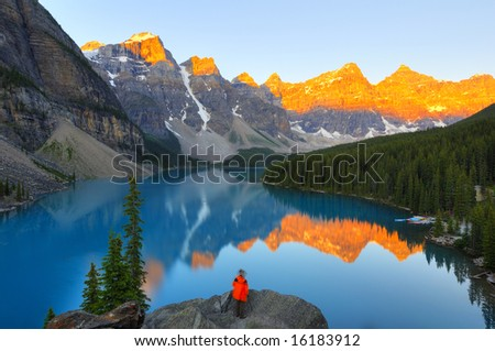 Photographer watches the amazing view of Lake Moraine, Banff, Canada - stock photo