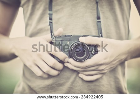 Photographer with a camera - stock photo