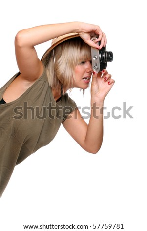 Photographer with camera dressed on safari suit.