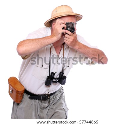 Photographer with camera dressed on suit for tropical destination. Studio shot isolated on white background. - stock photo