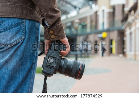Photographer with camera in the city - stock photo