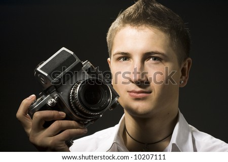Photographer with photo camera on hand
