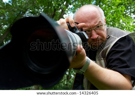 Photographer with professional telescopic lens.