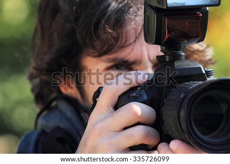 photographer with reflex camera and flash close up - stock photo
