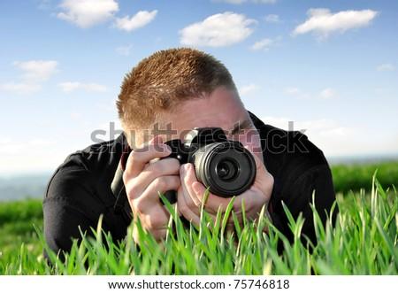 photographer  with SLR camera - stock photo