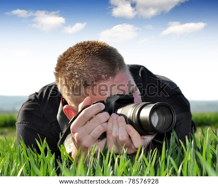 photographer with SLR camera - stock photo