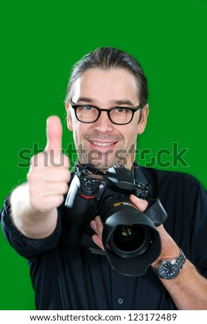 photographer with thumb up - stock photo