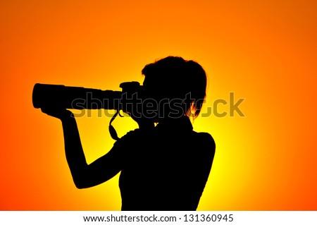 Photographer woman silhouette - stock photo