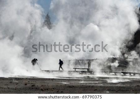 Photographers at Norris Geyser Basin, Yellowstone National Park - stock photo