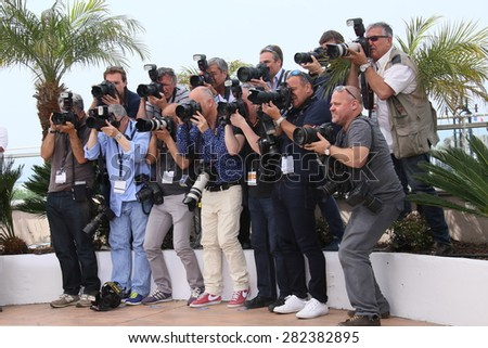 Photographers attend the 'La Tete Haute' ('Standing Tall') photocall during the 68th annual Cannes Film Festival on May 13, 2015 in Cannes, France. - stock photo
