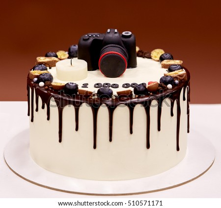 Photographers birthday cake with a photo camera on top