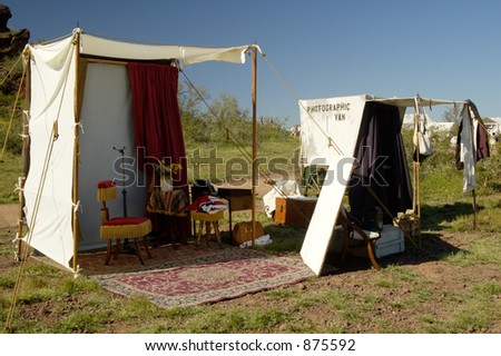 Photographers booth and van set up in a civil war encampment. - stock photo