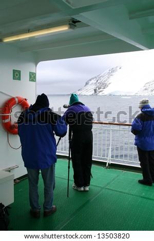 Photographers on cruise ship,Erreras Channel, Antarctica - stock photo