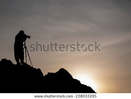 Photographers take pictures standing on the mountain to shoot the sunset in time twilight.