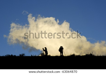 Photographers taking pictures in a Colorado field. - stock photo
