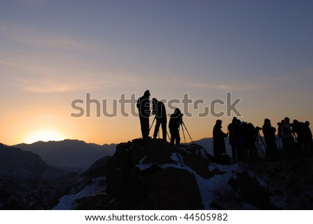 Photographers waiting for sunrise on the Great Wall. - stock photo