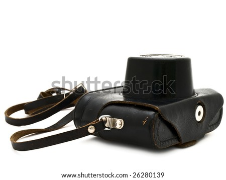 photographic camera in the black leather case - stock photo