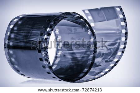 Photographic film in blue shades with reflections - stock photo
