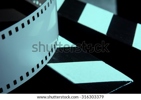 Photographic film. Movie clapper for shooting Films. - stock photo