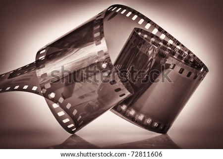 Photographic film on a dramatic dark  background - stock photo