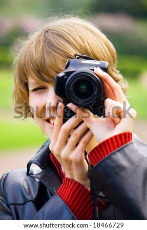 Photographing in park, young girl