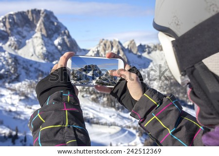 Photographing winter landscape mountains and snow, with cell phone - stock photo