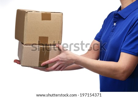photography bust a Delivery woman delivering parcels - stock photo