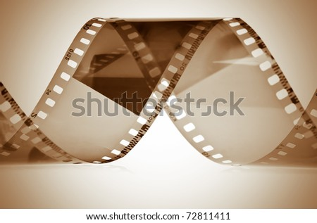 Photography film in sepia shades - stock photo