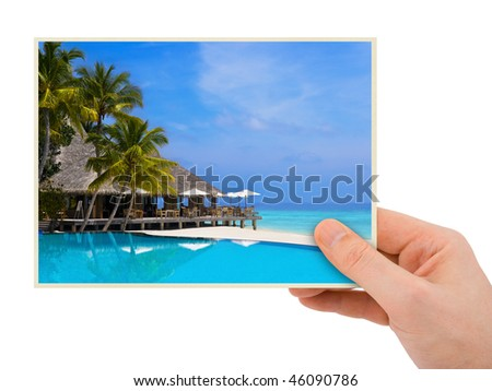 Photography in hand (my photo) isolated on white background