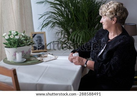 Photography is reminding the widow about her husband - stock photo