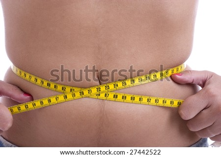 photography of a measuring tape around woman's waist