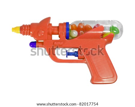 Photography of isolated plastic gun with candies - stock photo