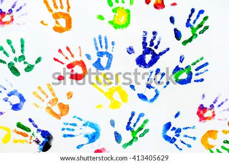 Photography of rainbow colors hands printed on white paper