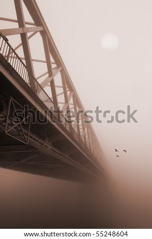 Photography of the bridge in sepia tones that vanishes into the thick fog. Three birds are flying away. Pale sun shines weekly through the fog. - stock photo
