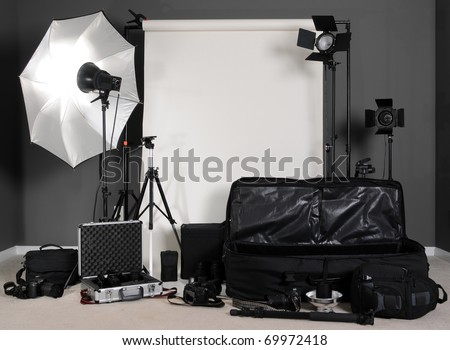 Photography Setup with Lights, Stands, Cameras, Bags and Backdrop - stock photo