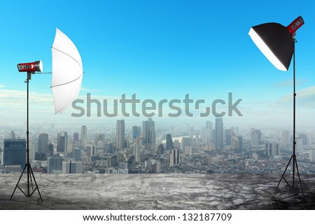 photography studio with a light set up on city buildings backdrop, Space for text or image - stock photo