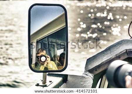 Photogrpher reflex on mirror. - stock photo