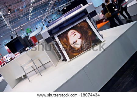 PHOTOKINA, COLOGNE - SEPTEMBER 28: Printers at Photokina - World of Imaging, Top Event for the Trade and User, September 28, 2008 in Cologne, Germany. - stock photo