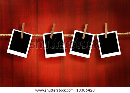 Photos frames on rustic red wood background - stock photo