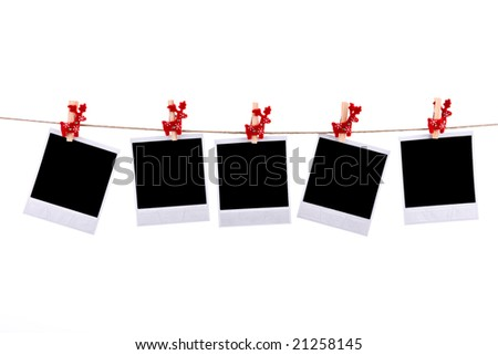Photos frames with christmas ornaments isolated on white background - stock photo
