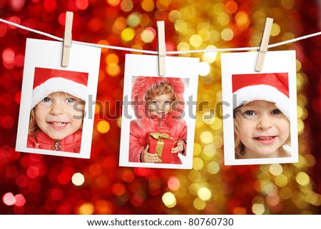 Photos of children against Christmas lights background - stock photo