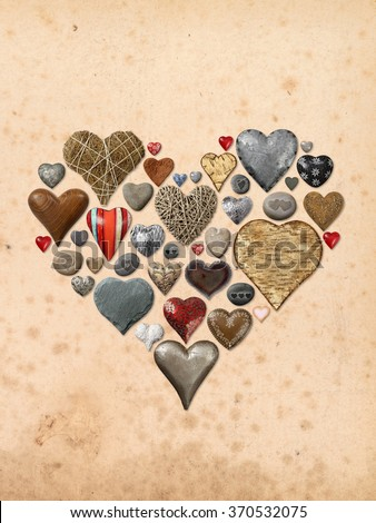 Photos of heart-shaped things made of stone, metal and wood, assembled into the shape of a heart over vintage paper background. - stock photo